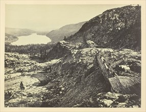 Summit of Sierra Nevada, Snow Sheds in Foreground, Donner Lake in the Distance, C. P. R. R., 1868/69 Creator: Andrew Joseph Russell.