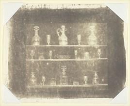 Articles of Glass on Three Shelves, c. 1844. Creator: William Henry Fox Talbot.