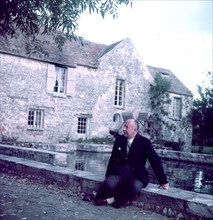Christian Dior in front of his house in Milly-la-Forêt