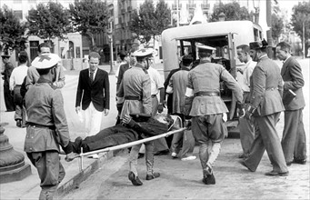 Injured man being evacuated, 1936