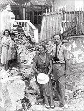 The Vice Consul of England in front of the ruins of the consulate, 1936