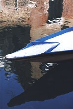 Gondola in Venice, reflections in a canal