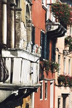Detail of a façade in Venice, balcony with four lions