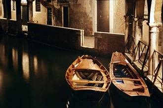 Two boats on the canal in Venice