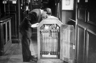 Man Looking into a Kinetoscope, Invented by Thomas A. Edison in 1889