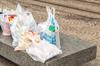 plastic bags lying on a concrete block