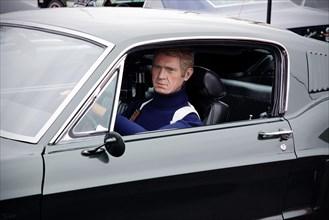 Steve McQueen model or mannequin in a Ford Mustang GT (the Bullitt film car).