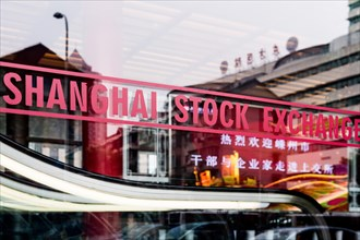 SHANGHAI, CHINA - January 2018: Shanghai stock exchange sign on glass window in China's most developed