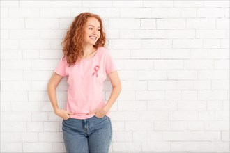 Girl In Breast Cancer T-Shirt Standing Over White Brick Wall