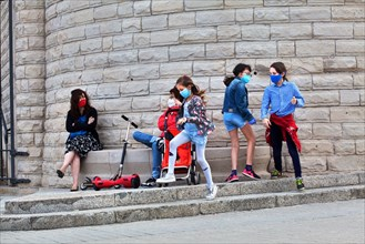 Two mothers and their children outside the Sagrada Familia, Barcelona.