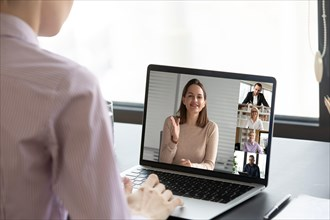 Female worker talk on video call with coworkers
