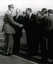 August 16, 1964, Côte d'Azur, France: French leader GENERAL CHARLES DE GAULLE at the commemoration of the 20th anniversary of Operation Dragoon, shaking the hand of American ambassador CHARLES BOHLEN,...