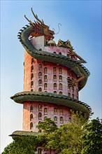 The pink tower with giant dragon at Wat SamPhran - Dragon temple, Nakhon Pathom, Thailand