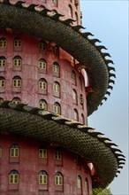 The part of pink tower with giant dragon at Wat SamPhran - Dragon temple, Nakhon Pathom, Thailand