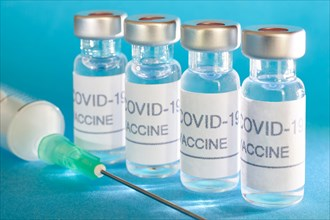 Covid-19 vaccine vials. Coronavirus pandemic infection. Global prevention vaccination
