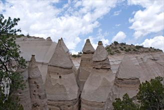 A group of 6 tent rocks at at the Kasha-Katuwe Tent Rocks National Monument