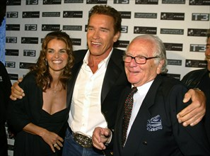 (dpa) - Hollywood actor Arnold Schwarzenegger (C) poses with his wife Maria Shriver and Italian fashion designer Pierre Cardin as he presents the third 'Terminator' film entitled 'T-3: Rise Of The Mac...
