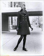 Jun. 15, 1969 - The little coat is still big news for Fall '69 from Originala, a brown double buttoned coat with lots of shaping has a regency collar and slanted patch pockets shoes by Pierre Cardin M...