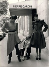 Jul. 22, 1979 - Pierre Cardin and his two models that are wearing pieces from his latest collection. On the left, she is wearing a suit jacket with a squared shoulder and an asymmetrical skirt over fi...