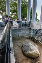 Plymouth Rock Portico containing the Plymouth Rock, the stone onto which the Mayflower Pilgims disembarked in 1620. Massachusett