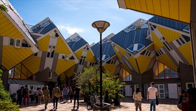 ROTTERDAM, NETHERLANDS - AUGUST 13, 2017 : Group of tourists in the yard of Cube houses or Kubuswoningen in Dutch are a set of innovative houses desig