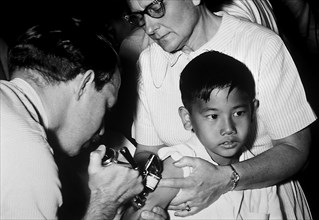 A jet injector gun being used during mass smallpox immunization procedures. Vaccinia vaccine is a highly effective immunizing agent that brought about the global eradication of smallpox, 1972. Because...