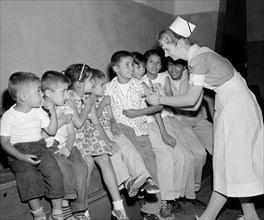 The new polio vaccine is given in Southern California,  ca. 1960.