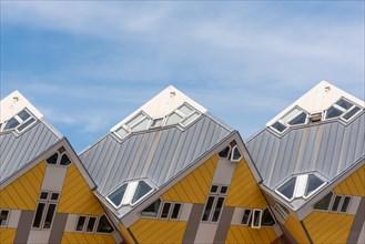 Rotterdam, Netherlands - April 23, 2019 : Yellow Cube houses - Kubuswoningen - in Blaak station area famous landmark of the city