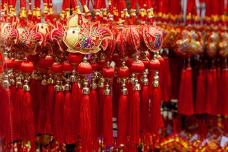 Chinese New Year ornaments on sale in Chinatown. These common ornaments have the Chinese words meaning Blessings and Peace printed on them. They are t