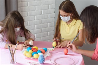 Quarantined sick family paints eggs for Easter