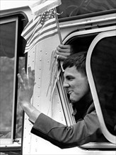 A former American hostage held by Iran waves from a buses during a welcome home parade along Pennsylvania Avenue January 27, 1981 in Washington, DC. Fifty-two Americans were held hostage for 444 days ...