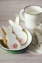 Rabbit shaped Easter cookies, hand-made. Decorated with fondant icing.