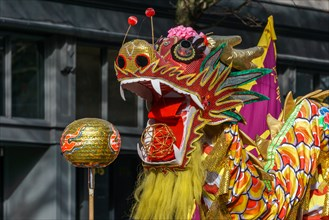 VANCOUVER, CANADA - February 18, 2018: People playing dragon dance for Chinese New Year in Chinatown.