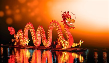 Chinese new year dragon lanterns on pond in china town