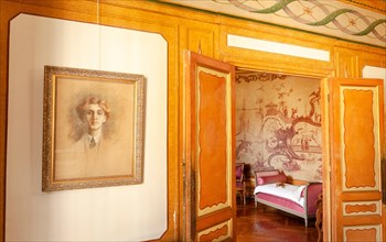 Portrait of Edmond Rostand near the door to Rosemonde's chamber at Villa Arnaga at Cambo-les-Bains, home to the poet Edmond Rostand