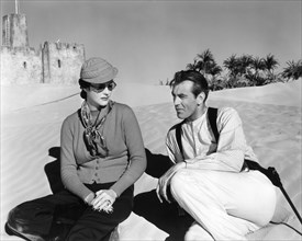 GARY COOPER visited by his wife SANDRA SHAW aka VERONICA BALFE aka ROCKY COOPER on set location candid in Yuma Arizona during filming of  BEAU GESTE 1939 director WILLIAM A. WELLMAN novel P.C. WREN Pa...