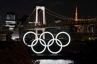 The Olympic rings are seen at Odaiba Marine Park in Tokyo, Japan on Friday, March 27, 2020. Japan's government and International Olympic Committee agreed to postpone the Tokyo 2020 Olympic Games until...