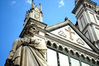 Firenze, Basilica of Santa Croce. Detail of the Dante Alighieri's statue closed to the gothic churc