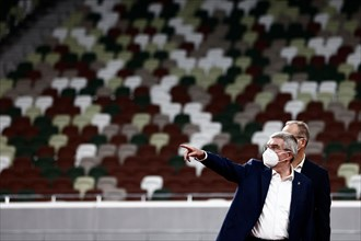 Tokyo, Japan. 17th Nov, 2020. International Olympic Committee (IOC) president Thomas Bach wearing a face mask visits the National Stadium, main venue for the 2020 Olympic and Paralympic Games postpone...