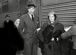 Gary Cooper arriving by train to Los Angeles, CA with his wife Veronica (Balfe) Cooper circa 1938 / File Reference # 34000-856THA