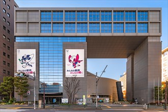 tokyo, japan - january 02 2021: Shinjuku Cosmics Center building decorated with posters of the 2020 Olympic and Paralympic Summer Games depicting the