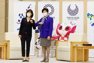Tokyo, Japan. 19th Feb, 2021. (L to R) Minister for the Tokyo Olympic and Paralympic Games Tamayo Marukawa and Tokyo Governor Yuriko Koike bump elbows at the Tokyo Metropolitan Government building. Ko...