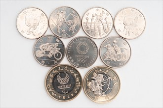 Tokyo, Japan - January 4, 2021: Commemorative coins of 100 yen and 500 yen for the Tokyo 2020 Olympic Games.