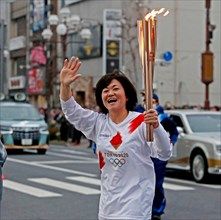 Isezaki City, Japan. 30th Mar, 2021. NO SALES IN JAPAN! Torch launcher runs with the Olympic torch through the city of Isezaki, Isesaki, torch relay, Olympic flame, flame, goalch relay, laughsd, wavin...