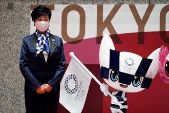 Tokyo, JPN. 14th Apr, 2021. Tokyo Gov. Yuriko Koike, stands next to the statues of Miraitowa, official mascot for the Tokyo 2020 Olympics to mark 100 days before the start of the Olympic Games Tokyo 2...
