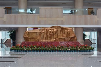 The symbolic Red Boat to commemorative the CPC first meeting in 1921. This is in the entrance to Jiaxing People's Government building.