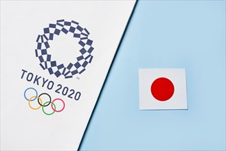 Tashkent, Uzbekistan - March 4, 2021: 2020 A towel with TOKYO 2020 Olympic games logotype and national flag of Japan