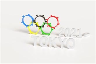 Olympic rings shaped like a coronavirus isolated on white background. Tokyo 2020. 3d Illustration.