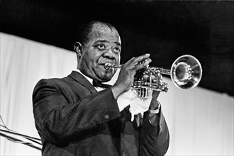 Louis Armstrong or Satchmo as he was known, the world's greatest trumpeter. Born on the 4 July