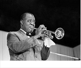 Louis Armstrong , Satchmo blows his trumpet at the Antibes Jazz Festival